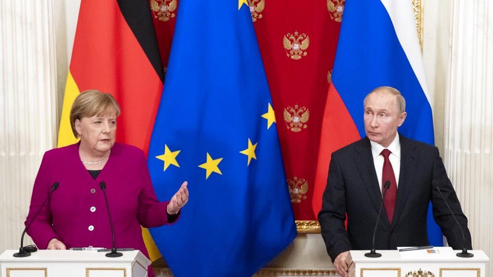 Putin ve Merkel'den Libya krizi için çözüm!