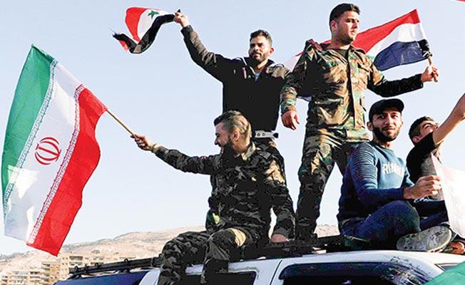 İran: Suriye rejimi istediği sürece orada kalacağız